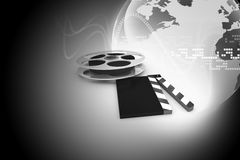 Cinema clap and film reel. 3d illustration of cinema clap and film reel, over abstract background Royalty Free Stock Photography