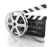 Cinema clap and film reel . Cinema clap and film reel, over white background Royalty Free Stock Image
