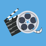 Cinema clap and film reel. Vector illustration in flat style Royalty Free Stock Photos