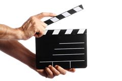 Cinema clap. Two hands holding a cinema clap isolated on white Royalty Free Stock Image