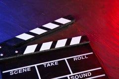 Cinema clapboard on black stone Stock Image