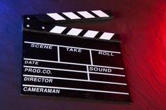 Cinema clapboard on black stone Stock Photography