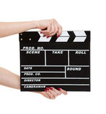 Cinema clapboard in female hands Stock Images