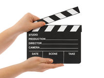 Cinema clapboard in hands
