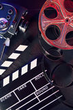 Cinema clapboard and reel on black stone Royalty Free Stock Photography