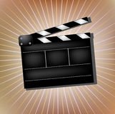 Cinema clapper. On abstract background Stock Photos
