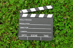 Cinema clapper board on green grass Royalty Free Stock Photo