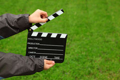 Cinema clapper board in hands of boy Stock Image