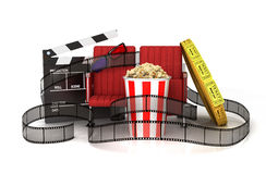 Cinema clapper board, popcorn,. 3d glasses, theater seat and tickets wrapped film strip Stock Photography