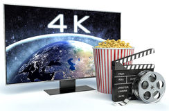 Cinema clapper, popcorn and 4k TV. 3d image Royalty Free Stock Image