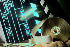 Cinema clapper and video film negative movie on a rough cloth Stock Images