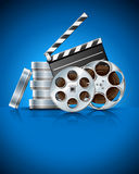 Cinema clapper and video film tape on disc. Illustration on blue background Stock Photos