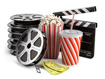 Cinema concept. Clapper board, film reels, popcorn, cola, cinema tickets Stock Photos