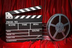 Cinema concept. Clapperboard with and film reels on the red fabric, 3D rendering. Cinema concept. Clapperboard with and film reels on the red fabric, 3D vector illustration