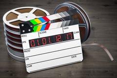 Cinema concept. Digital movie clapper board with film reels, 3D. Cinema concept. Digital movie clapper board with film reels Royalty Free Stock Images