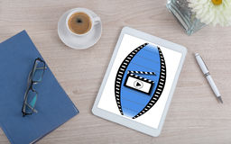 Cinema concept on a digital tablet. Top view of a desk with cinema concept on a digital tablet Royalty Free Stock Photography