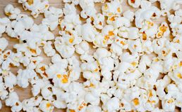 Popcorn arranged on wooden background stock photography