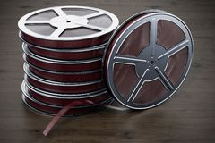 Cinema concept. Film reels on the wooden table, 3D rendering. Cinema concept. Film reels on the wooden table, 3D stock illustration