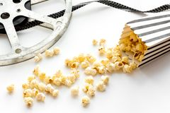 Cinema concept. film stock and popcorn on white background stock image