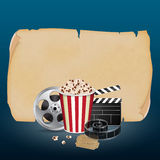 Cinema concept. Filmstrip, reel, film clapper with vintage ticket and popcorn on blue background. Cinema concept. EPS10 vector Royalty Free Stock Images