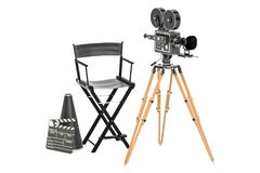 Cinema concept. Movie camera with film reels, chair, megaphone a. Nd clapperboard. 3D rendering isolated on white background Royalty Free Stock Image