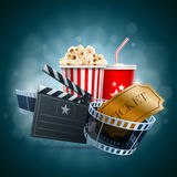 Cinema concept. Popcorn box, disposable cup for beverages with straw, film strip, ticket and clapper board. Detailed vector illustration. EPS10 file Royalty Free Stock Image