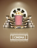 Cinema concept with popcorn and cinefilms retro style Royalty Free Stock Photo