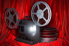 Cinema concept. Cinema projector with movie reels on the red fabric, 3D rendering. Cinema concept. Cinema projector with movie reels on the red fabric, 3D vector illustration