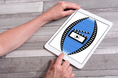 Cinema concept on a tablet. Cinema concept shown on a tablet used by a woman Royalty Free Stock Photography