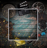 Cinema concept of vintage film reels, clapperboard and other tools. Royalty Free Stock Images