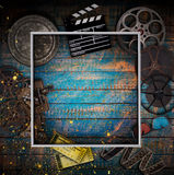 Cinema concept of vintage film reels, clapperboard and other tools. Stock Photos