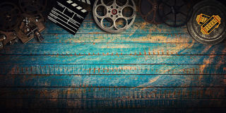 Cinema concept of vintage film reels, clapperboard and projector. Stock Photos