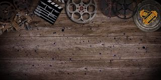 Cinema concept of vintage film reels, clapperboard and projector. Royalty Free Stock Photos