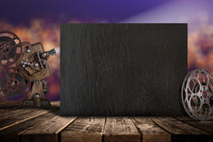 Cinema concept of vintage film reels, clapperboard and projector. Royalty Free Stock Images