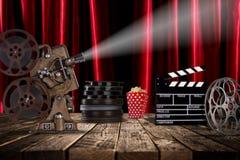 Cinema concept of vintage film reels, clapperboard and projector. Cinema concept of vintage film reels, clapperboard and projector ond old wooden background royalty free stock image