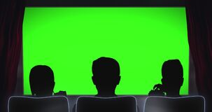 Cinema curtain opens in front of silhouettes of people looking at green screen