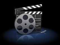 Cinema. 3d illustration of cinema clap and film reel, over dark background Stock Photography