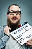Cinema Director with a Slate in His Neck Royalty Free Stock Photo