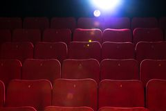 In a cinema. Empty comfortable red seats with numbers in cinema Royalty Free Stock Photo