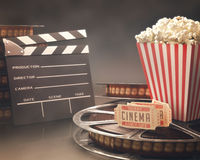 Cinema Festival. Objects related to the cinema on reflective surface Royalty Free Stock Photo