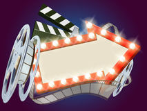 Cinema Film Arrow Sign Background. Movie cinema film sign with light bulbs arrow sign clapperboard and film reel Stock Images