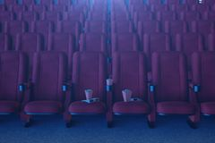 Cinema film concept with popcorn, 3d glasses, popcorn and cup with a drink. Cinema concept with blue light. Red chairs vector illustration