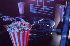 Cinema film concpet with popcorn, 3d glasses, filmstrip, clapperboard movie reel and two tickets. Cinema concept wtih. Blue light. Red chairs in the cinema hall royalty free illustration