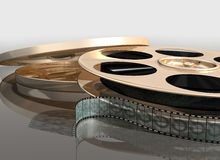 Cinema film reel. Illustration of a cinema film reel next to its canister royalty free illustration
