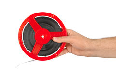 Cinema film reel in hand. Isolated on white background Royalty Free Stock Image