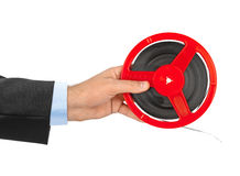 Cinema film reel in hand. Isolated on white background Stock Photography