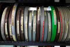 Cinema Film Reels. EUGENE, OR - APRIL 10, 2015: Film reels for a cinema studies class on shelves in a video library stock photography