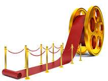Cinema film roll and red carpet. 3d illustration.  Royalty Free Stock Images