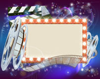 Cinema Film Sign Background. An abstract movie cinema film sign with light bulbs sign clapperboard and film reel Royalty Free Stock Photography