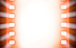 Cinema film strips with and projector light rays. Royalty Free Stock Photo
